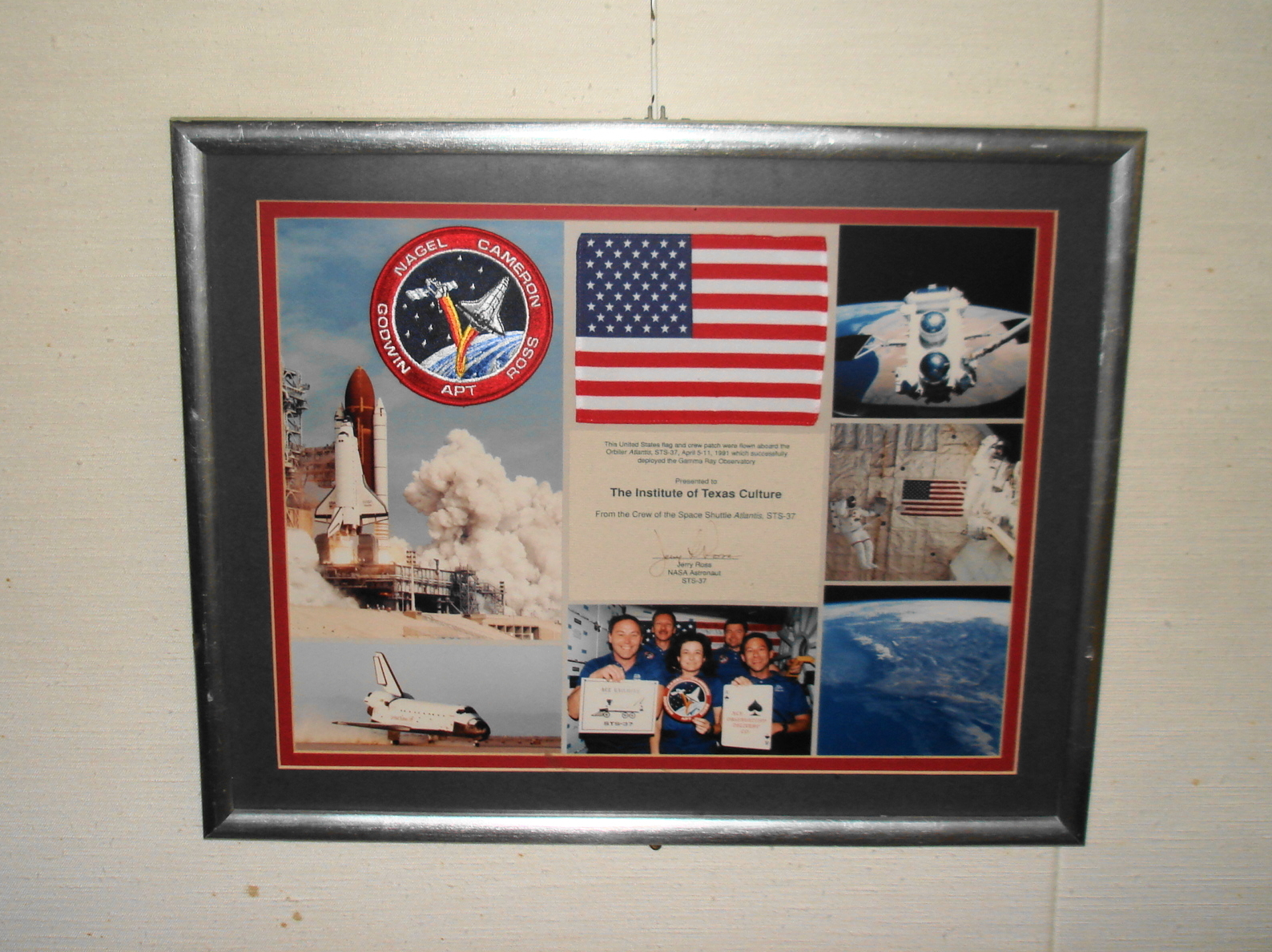 Object: Flag & Patch (Framed small US Flag & Crew Patch from space shuttle Atlantis)   UTSA Institute Of Texan Cultures
