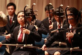 Erhu players in a Chinese orchestra in Yishun Junior College.