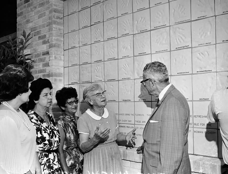 <strong>Attendees outside the dedication of the Wall of Hands</strong><div>July 29, 1968. Following dedication of the Wall of Hands at entrance to Woman's Pavilion at HemisFair '68, Mayor Walter W. McAllister speaks with Ethel Wilson Harris who directed the work of fabricating the tiles, with women's handprints, representing the work of women. From left: Lila Cockrell, Mamie Sandoval, Lucille Carmona, Ethel Harris and Mayor W. W. McAllister.</div>