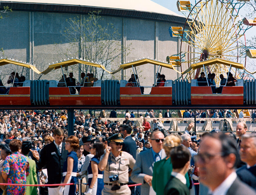<strong>Crowd shot, with monorail, Ferris Wheel, and arena in background</strong><div>1968. HemisFair '68 crowd shot, with monorail, Ferris Wheel, and arena in background.</div>