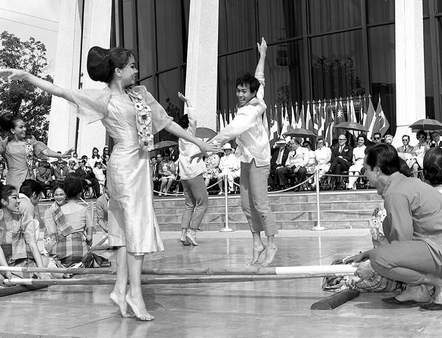 <strong>Filipino Bayanihan dance troupe performs for ambassadors and other dignitaries</strong><div>July 4, 1968. Filipino Bayanihan dance troupe performs for visiting ambassadors and other dignitaries outside the U.S. Pavilion at ceremony ending the daylight portion of the Independence Day Celebration at HemisFair '68.</div>
